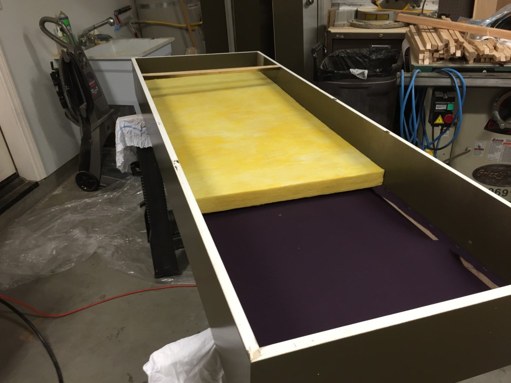 First fiberglass panel goes into the box