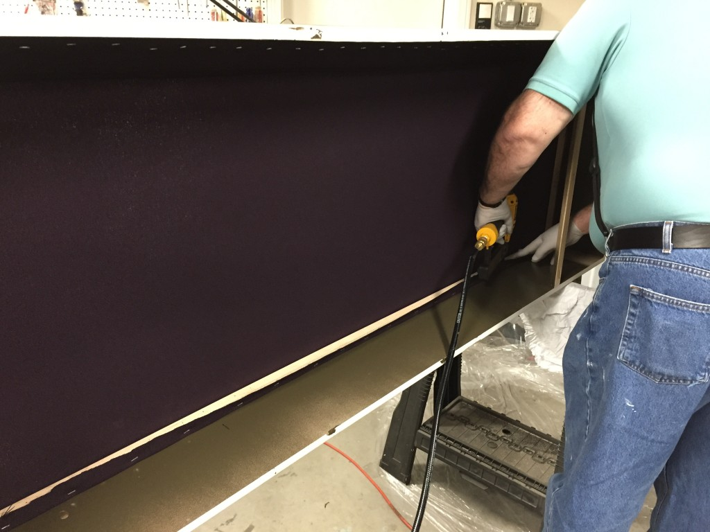 Attaching fabric frame to a box